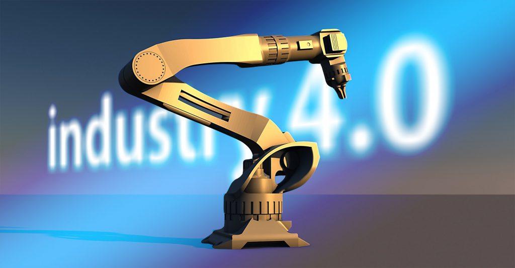 """Robottikäsi, jossa työkalu. Taustalla teksti """"Industry 4.0""""."""
